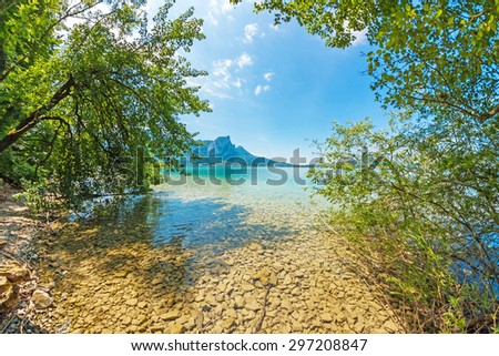 alpine lake Attersee with crystal water - stock photo