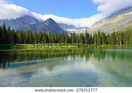 alpine lake Josephine on the Grinnell Glacier trail in Glacier National Park in summer - stock photo