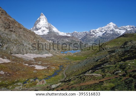 Alpine landscape with Matterhorn peak view at sunny day - stock photo