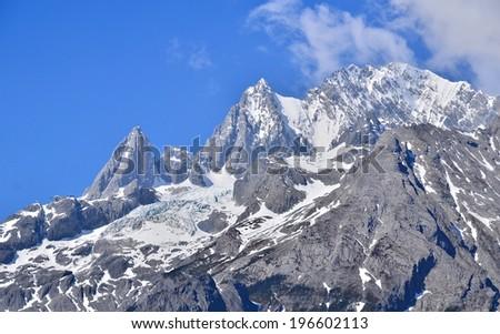 Alpine Mountain Peak in the Mist - stock photo