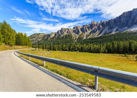 Alpine road and mountain peaks near Passo Giau - Dolomites Mountains, Italy - stock photo
