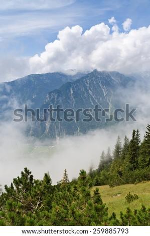 Alpine scenery with view through clouds, Rofan mountains, Maurach am Achensee, Tyrol, Austria - stock photo