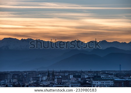 Alpine snowcapped peaks at sunset in Turin, Italy. - stock photo