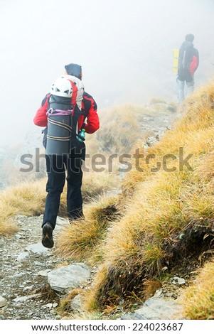 Alpine trekking - harsh conditions - stock photo