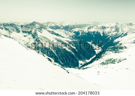 Alpine valley surrounded with snow covered mountain, Mallnitz, Austria - stock photo