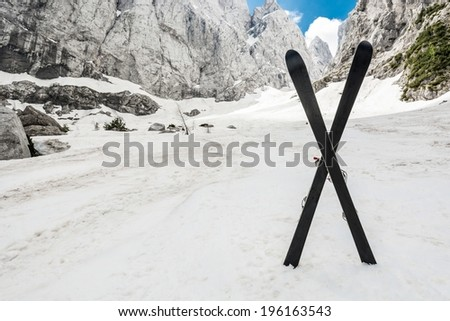 Alpine valley with a pair of crossed skis, Slovenia - stock photo