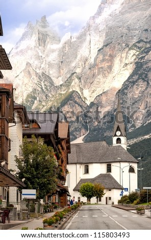 Alpine village in Dolomites Alps, Tirol, Italy - stock photo
