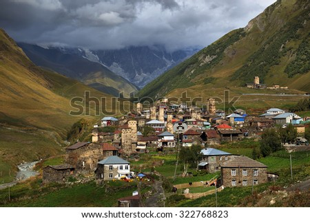 Alpine village in Svaneti mountains in the background - stock photo