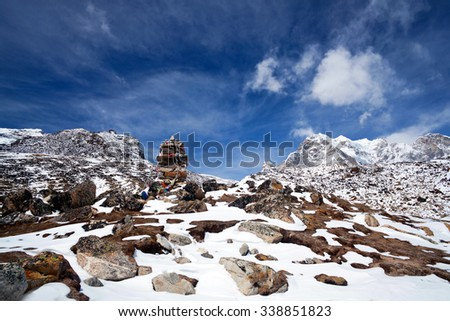 Alpinism in Nepal - tombstones or chorten for climber who died in Himalayas in Sagarmatha National Park.  - stock photo