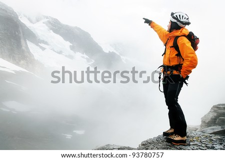 Alpinist contemplating the Eiger Glacier, Switzerland - stock photo