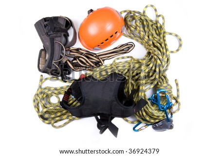Alpinist, mountain climber, or ropejumper tools kit - - stock photo