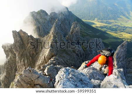 Alpinist on Koenigsjodler route - stock photo