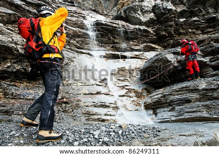 Alpinists climbing Eiger Peak, Switzerland - stock photo