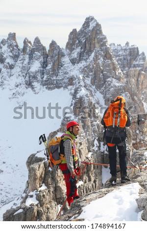 Alpinists climbing ferrata La torre di Toblin (2.617 m), Dolomites, Italy, Europe - stock photo