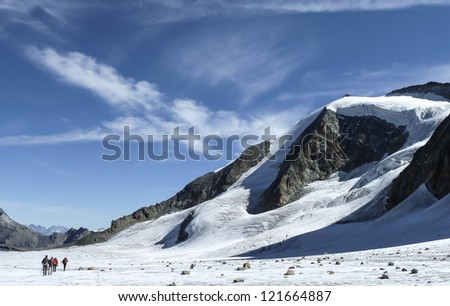 Alpinists crossing the Glacier du Gietro - stock photo