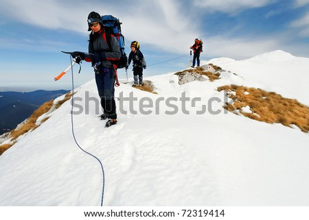 Alpinists resting after climbing - stock photo