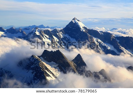 Alps Alpine Landscape of Mountain Cook Range Peak with mist from Helicopter, New Zealand - stock photo