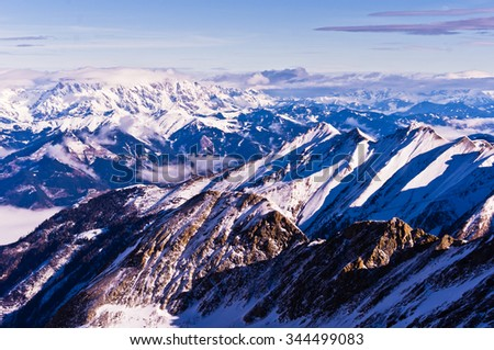 Alps landscape in the morning sun, viewed from the top of Kaprun Glacier in Austrian Alps, Tyrol, Austria - stock photo