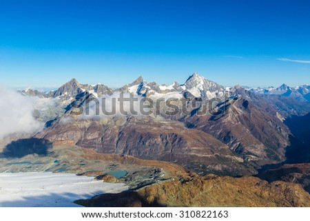 Alps mountain landscape and mountain lake in a beautiful day in Switzerland - stock photo