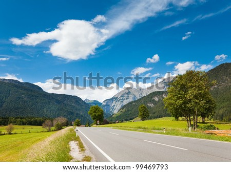 Alps mountain tranquil summer view with road (Austria, Gosau village outskirts) - stock photo