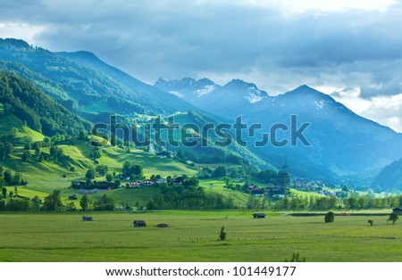 Alps mountains summer view and village in valley (Austria) - stock photo