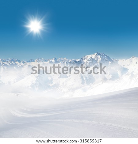 Alps  panorama view in winter snow time with ski slope - stock photo