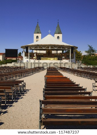 Altar and the Church of St. James, in a holy place of pilgrimage - Medjugorje, Bosnia and Herzegovina. Balkans, summer day. - stock photo