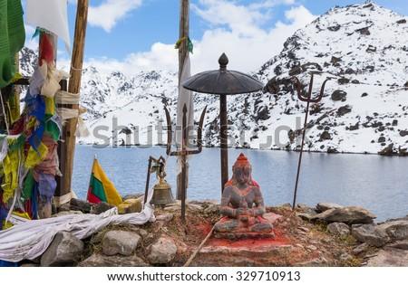 Altar religious buddhist hindu shrine, Buddha figure statue praying flags. Gosaikunda lake trekking route, Langtang snow mountains region, Nepal - stock photo