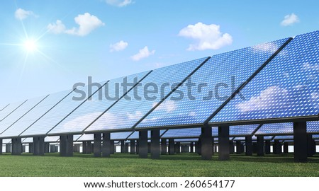Alternative Energy Concept. Modern Solar Panels Farm on beautiful Green Grass with Sunshine and Clouds  - stock photo