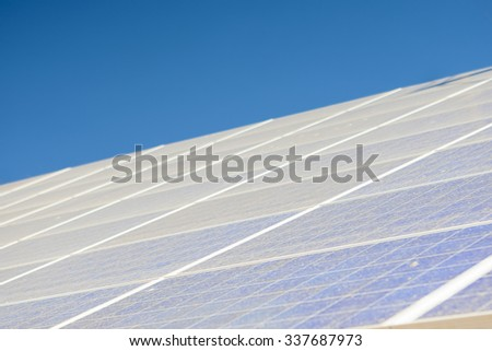 Alternative Energy Concepts: Solar Panels Array Against Blue Sky. Horizontal Image Composition - stock photo