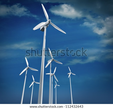 Alternative energy. Group of energy-producing windmills - stock photo