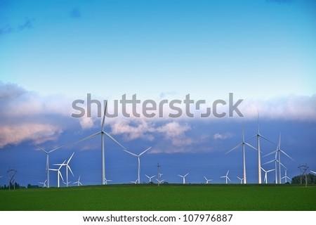 Alternative Energy Landscape - Wind Turbines Farm in Minnesotas Mower County near Dexter, MN. Wind Turbines in Sunset - stock photo