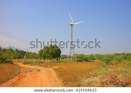 Alternative energy sources 8. Wind farm in Indian province of Kerala. Many wind-powered generators stand opposite to mountainous terrain - stock photo