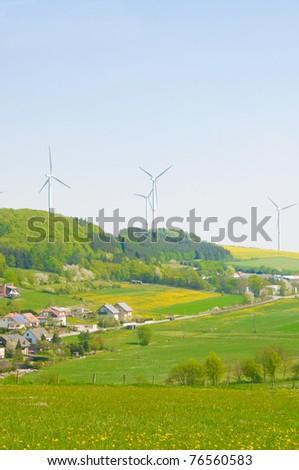 Alternative energy  - windmills and solar panels. - stock photo
