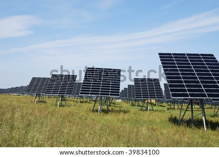 Alternative energy with a field of solar panel field - stock photo