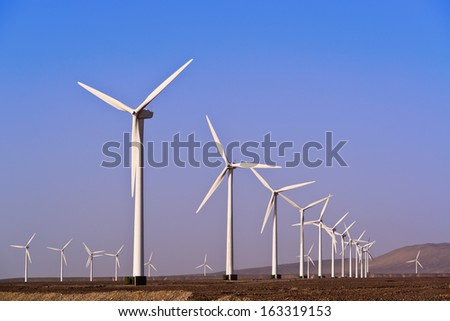 Alternative energy with wind turbine - stock photo