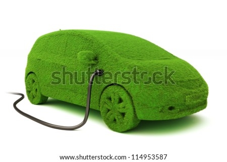 Alternative power concept eco car . Grass covered car plugged into power supply on a white background. - stock photo