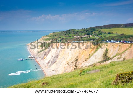 Alum Bay Isle of Wight beautiful beach and rocks next to the Needles tourist attraction - stock photo