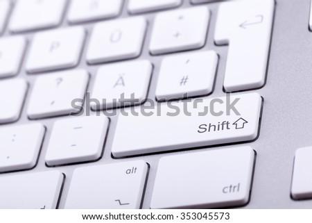 Aluminium keyboard close up shooting. Studio photo. Standard keyboard in close up shooting with blurred background - stock photo
