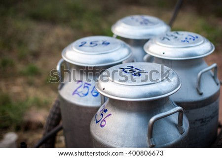aluminium milk cans - stock photo