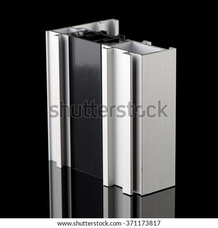 Aluminium profile sample isolated on black background. - stock photo