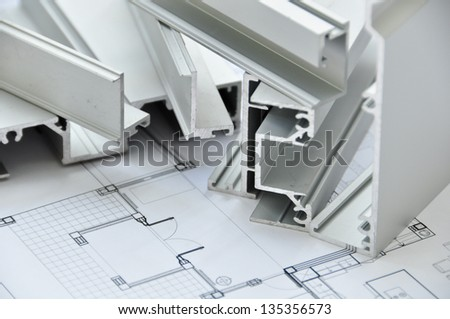 Aluminium profile with Architectural drawing - stock photo