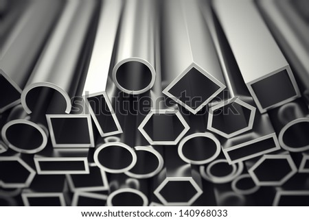 Aluminium profiles in different shapes are designed to meet high demands for performance, quality and precision. They are used in construction and manufacturing. - stock photo