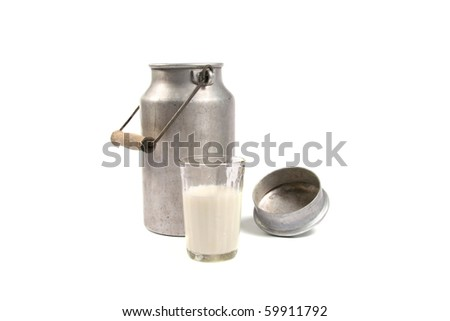 aluminum can and glass of milk - stock photo