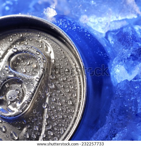 aluminum can of soda in the ice - stock photo