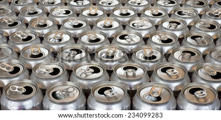 aluminum can recycling close up view tops of empty cans landscape  - stock photo