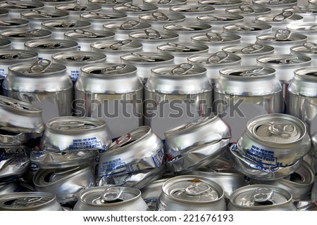 aluminum can recycling landscape close view crushed and uncrushed cans - stock photo