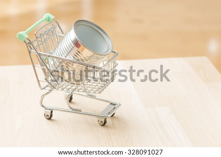 Aluminum cans ready for recycling on kitchen table. Concept of green lifestyle, garbage and responsibility. - stock photo