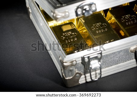 Aluminum Case Full Of Gold Bars - stock photo