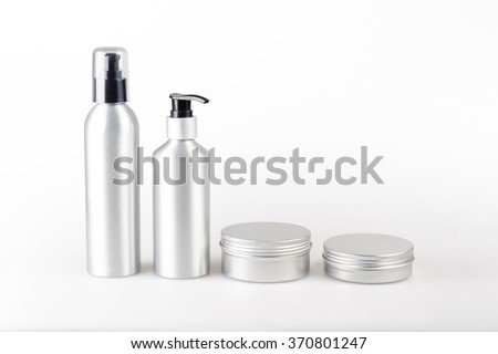 Aluminum cosmetic dispenser bottles and cartridges - stock photo